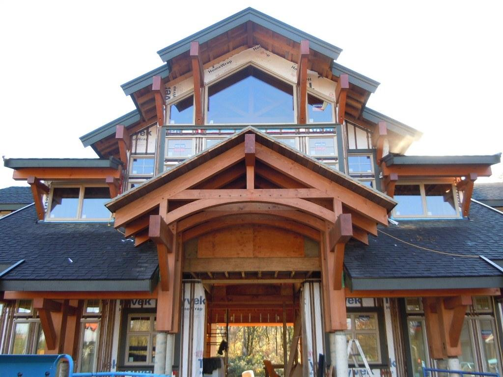 Hybrid timber frame construction bc canada moore log for Hybrid timber frame home plans